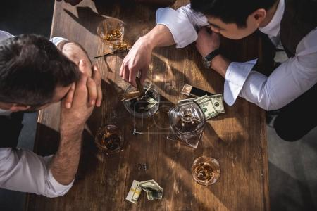 colleagues drinking alcohol while spending time together after work