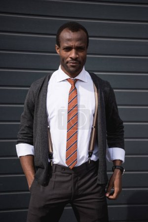 young confident african american businessman standing outdoors