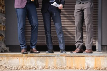 Photo for Cropped shot of stylish businessmen in formalwear meeting outdoors at break, business team meeting - Royalty Free Image