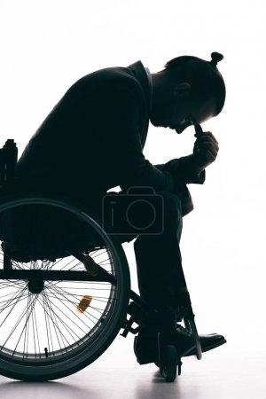 Depressed man in wheelchair