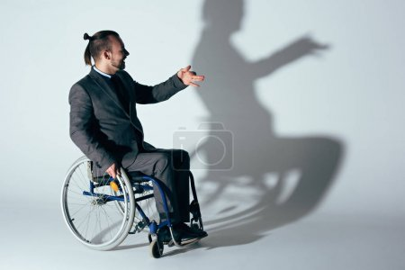businessman in wheelchair making shadow of dog