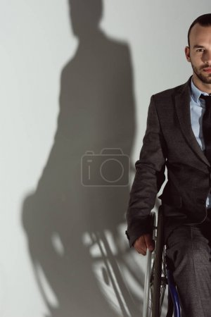 Businessman sitting in wheelchair