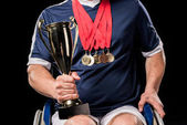 paralympic in wheelchair with trophies