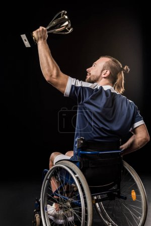 Disabled sportsman holding trophy