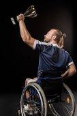 Disabled sportsman holding trophy