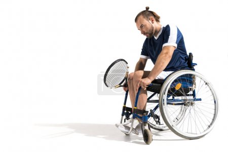 pensive disabled tennis player
