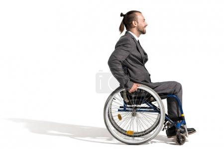 smiling businessman in wheelchair
