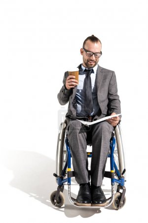 Disabled businessman reading newspaper