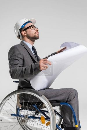 disabled architect with blueprint