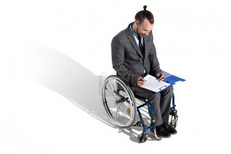 Businessman in wheelchair signing contract