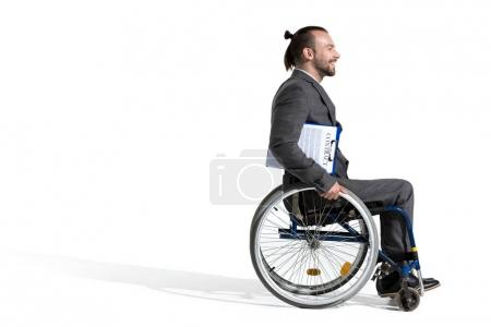 businessman in wheelchair holding clipboard with contract