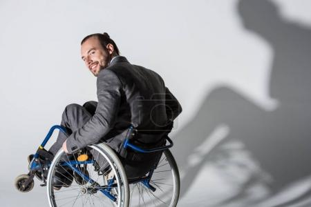 physically handicapped businessman in wheelchair with shadow