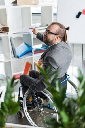 Physically handicapped businessman doing paperwork