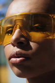 stylish girl in protective goggles