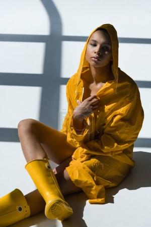 african american woman in raincoat