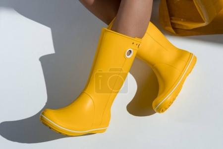 woman in yellow rubber boots