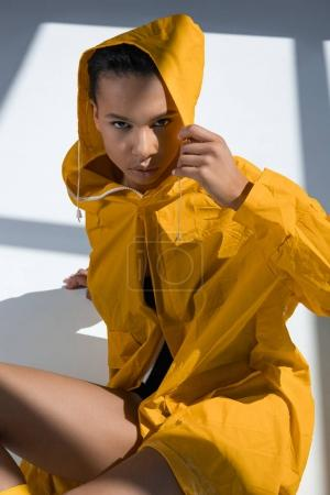 Gorgeous young woman in raincoat