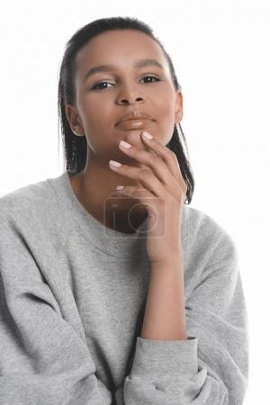 Photo for Sensual african american girl with hand on chin posing in grey sweater isolated on white - Royalty Free Image