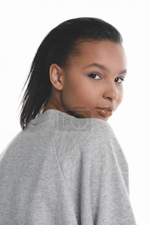 Young woman in grey sweater