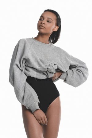 Young woman in bodysuit and sweater