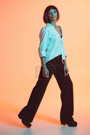 Photo for Young stylish african american woman posing at studio - Royalty Free Image