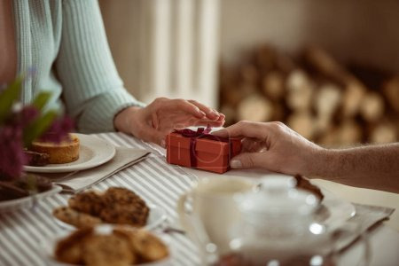 husband giving present to wife