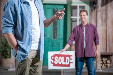 man buying new house