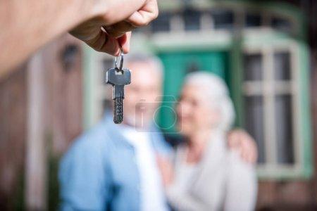 saleman holding keys