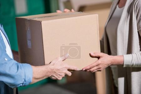 Senior couple with cardboard box