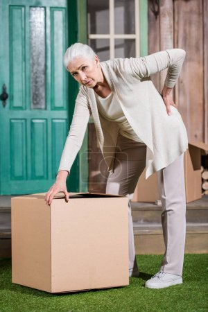 Senior woman with cardboard box