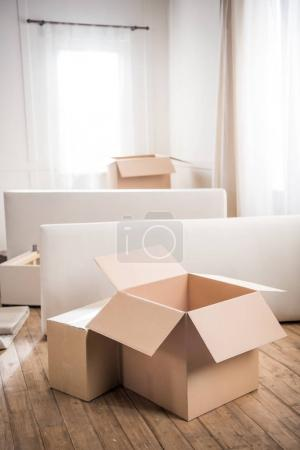 Cardboard boxes in empty room