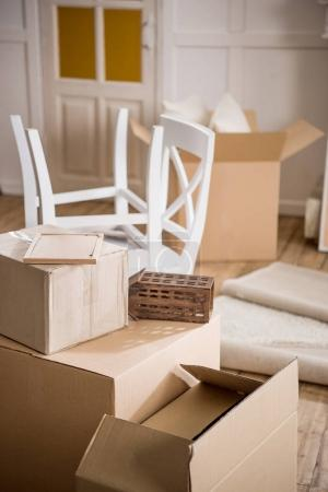 Photo for Cardboard boxes and furniture in empty room, relocation concept - Royalty Free Image