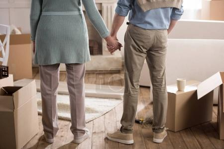 Photo for Cropped shot of couple holding hands while standing at new home - Royalty Free Image