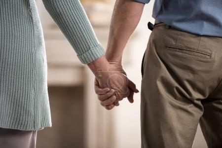 couple holding hands at new home