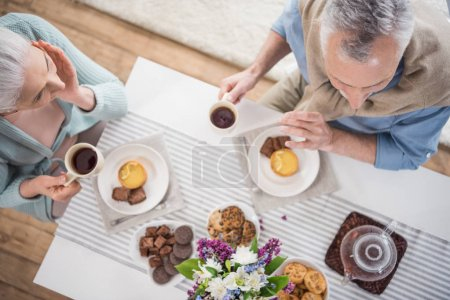 senior couple having breakfast at home