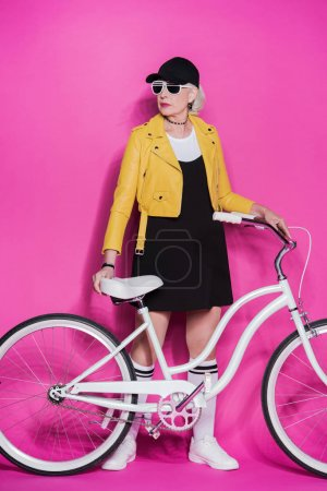 senior woman with bicycle