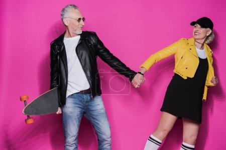 Senior couple with skateboard