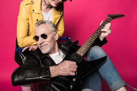 Senior couple with electric guitar