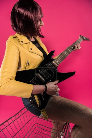 Senior woman with electric guitar