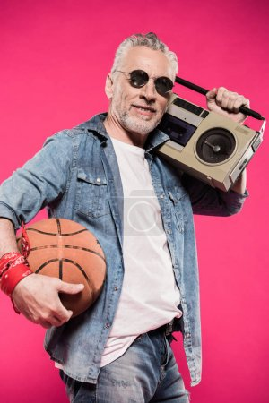 man with tape recorder and basketball ball