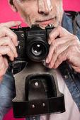 Man with retro photo camera
