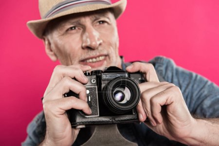 man with retro photo camera