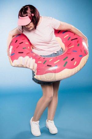 Stylish woman with swimming tube
