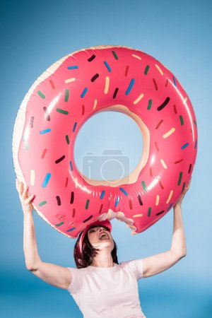 woman with float ring in form of doughnut