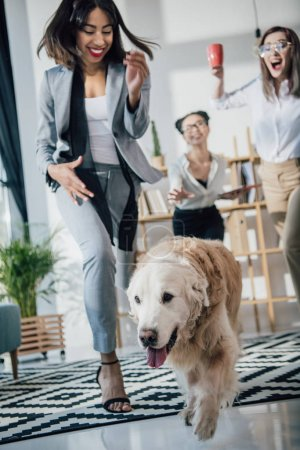 Businesswomen with dog in office