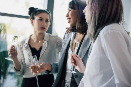 Businesswomen drinking champagne