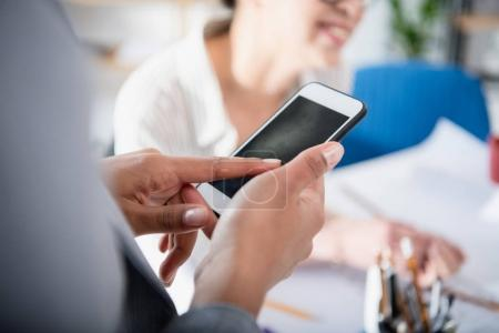 Photo for Cropped shot of businesswoman using smartphone with blank screen - Royalty Free Image
