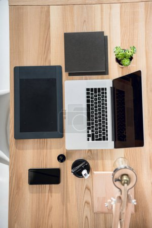 laptop with graphics tablet and smartphone on tabletop