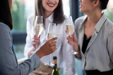 Businesswomen in formal wear drinking champagne