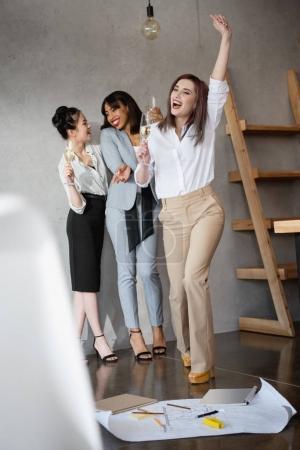 multiethnic businesswomen celebrating success